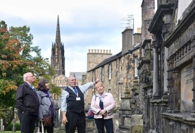 tour guide showing visitors around the kirk