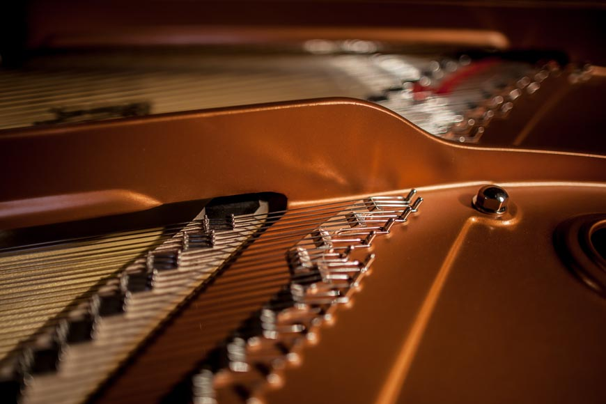a close up image of a piano in a church