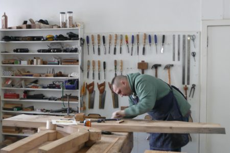 a view of a worker in a woodworking shop