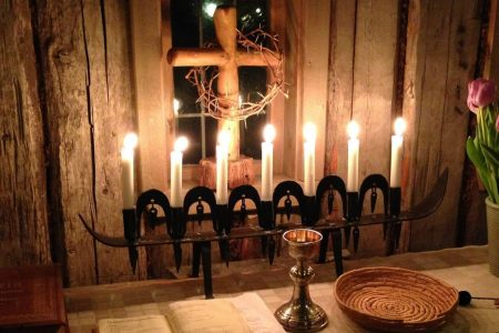 an image of a candlelit communion table