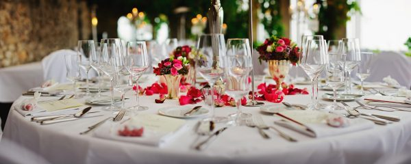 a view of a table covered in beautiful flowers and delicate china