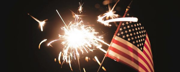 view of an american flag and a sparkler