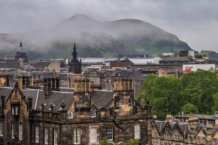 view of the old town in edinburgh, covered in fog and haze