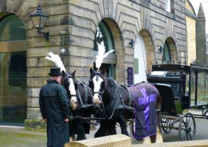 view of a horse-drawn hearse outside of Greyfriars Kirk